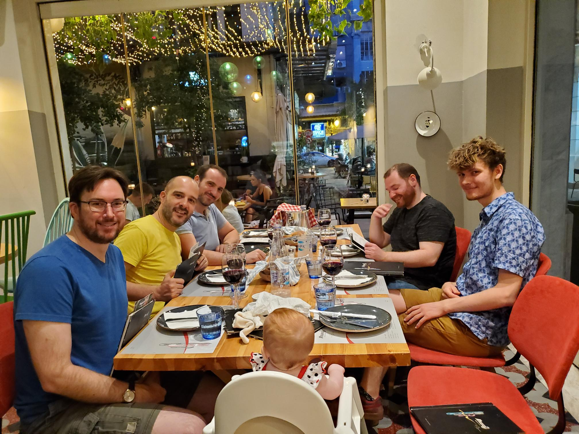 Purism team members sitting around a dinner table at a restaurant