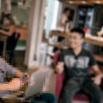 Pixelized people sitting at a cafe